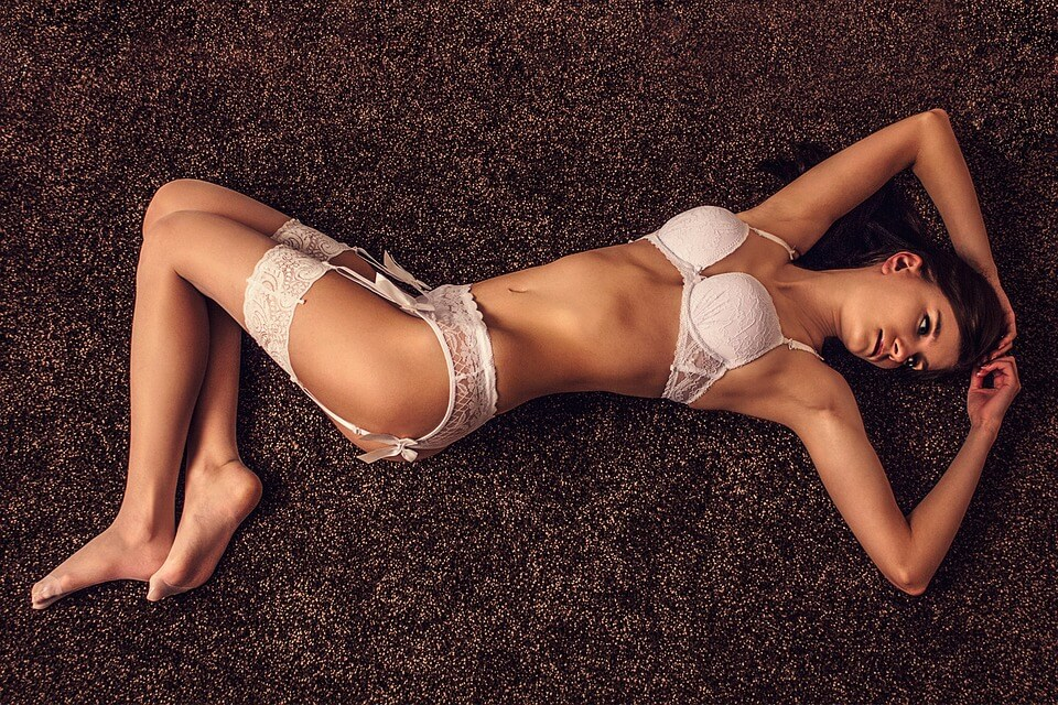 Girl posing on the floor with white lingerie